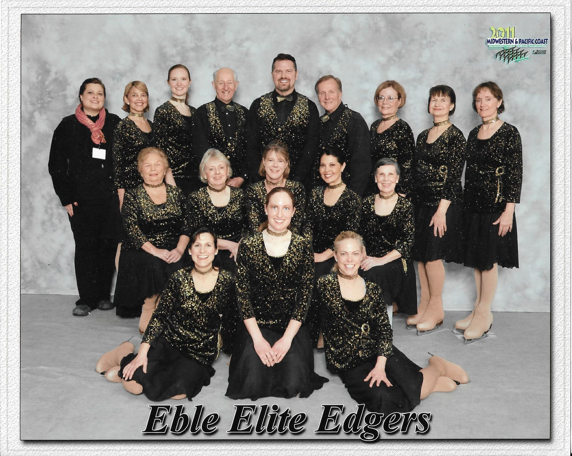 An old team photo of the Eble Elite Edgers wearing black costumes.