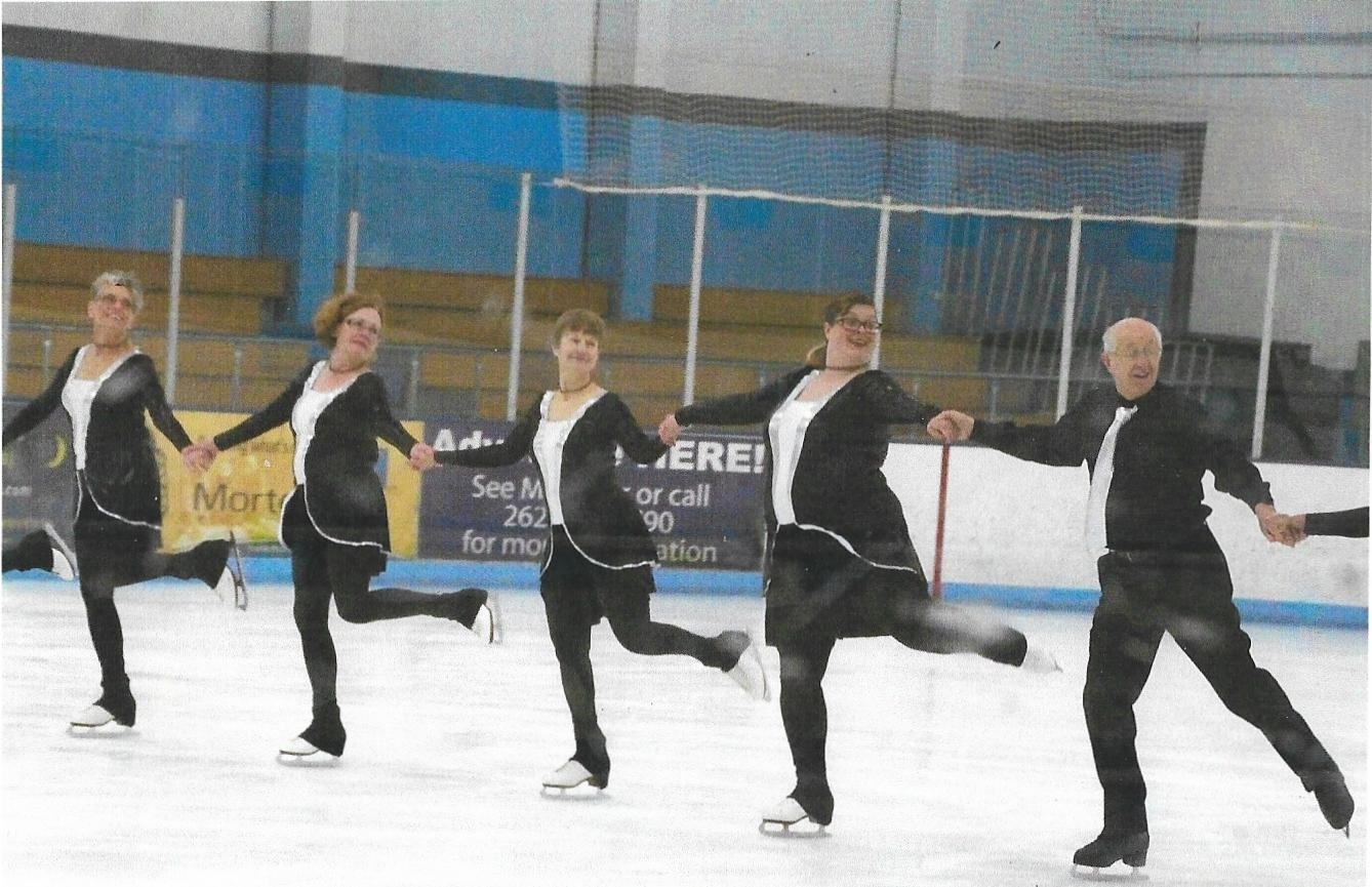 The Eble Elite Edges practice at the rink in a line.