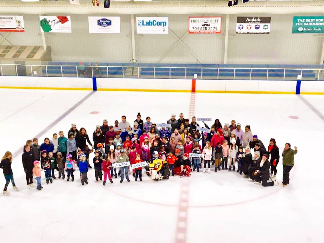 extreme ice center national skating month aerial group shot