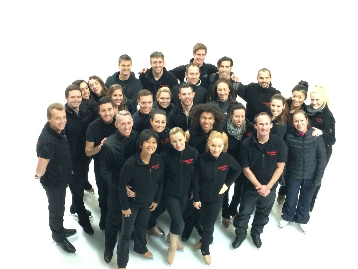A group shot of skaters in all black featuring Sarah Kawahara.