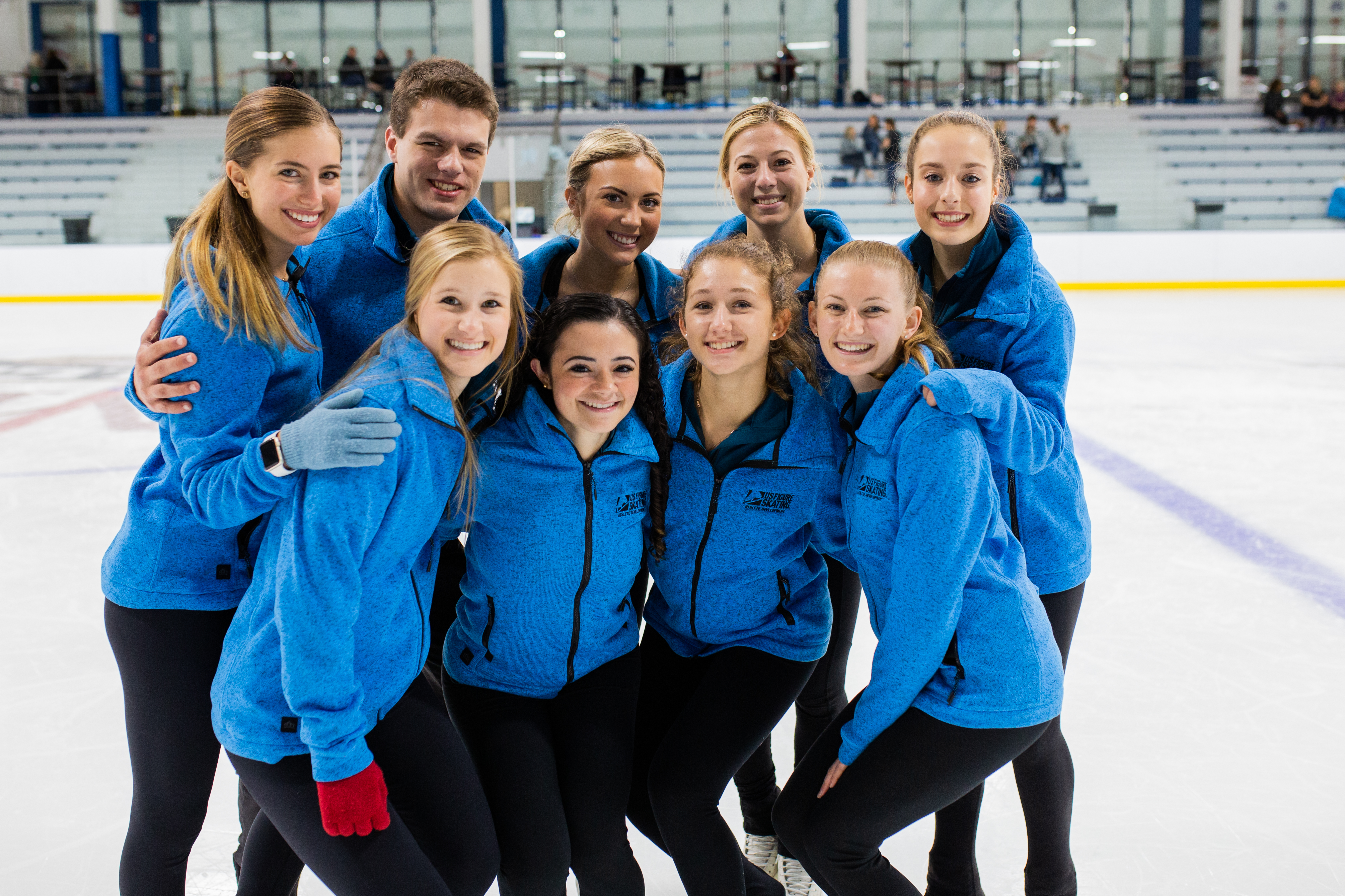 2019-20 DREAM Skaters pose for the camera on ice.