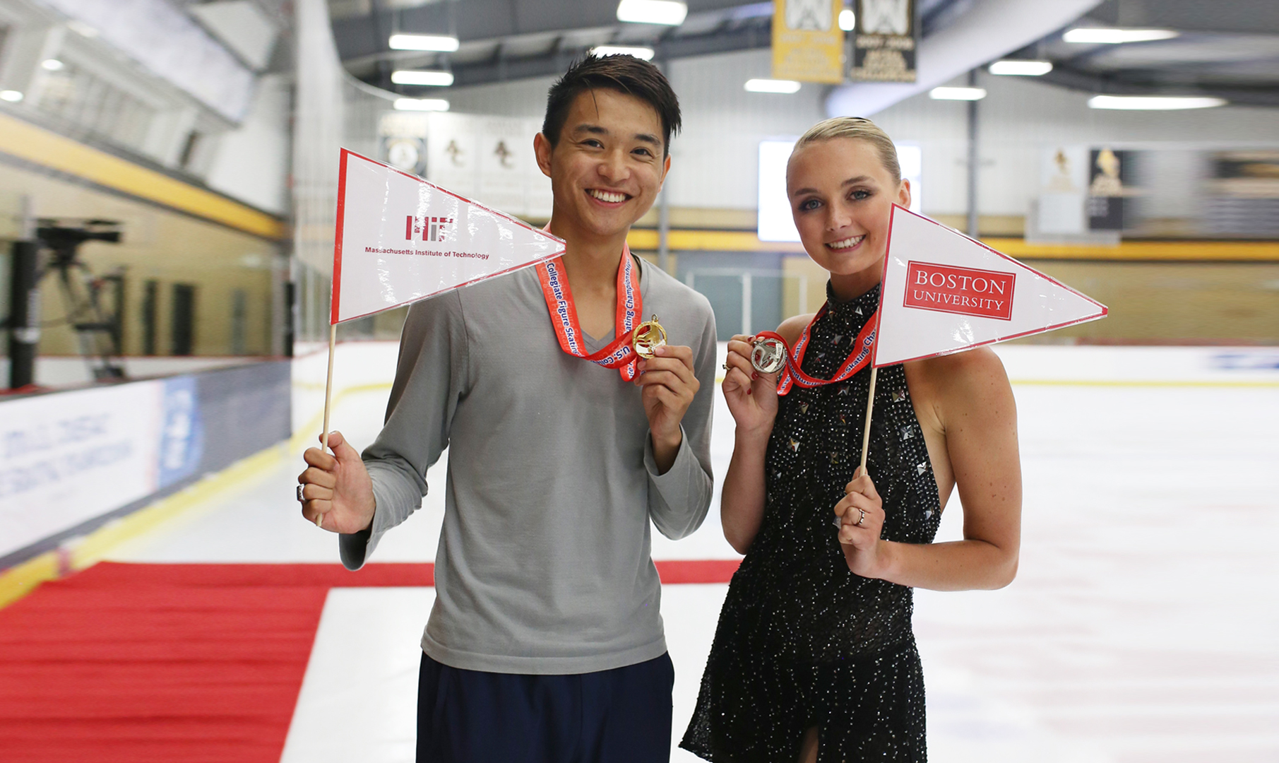 Skaters pose with awards at the U.S. Collegiate Figure Skating Championships.