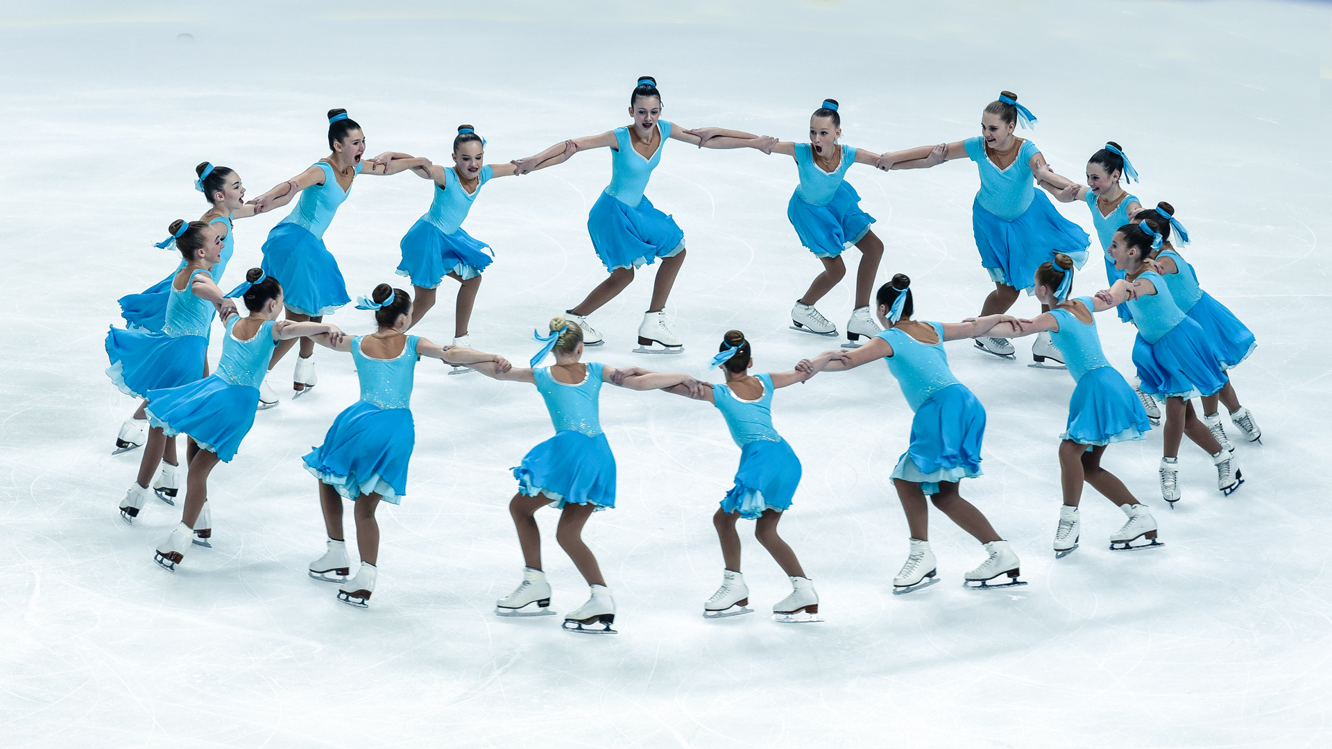 A young synchro team performs a rotational element