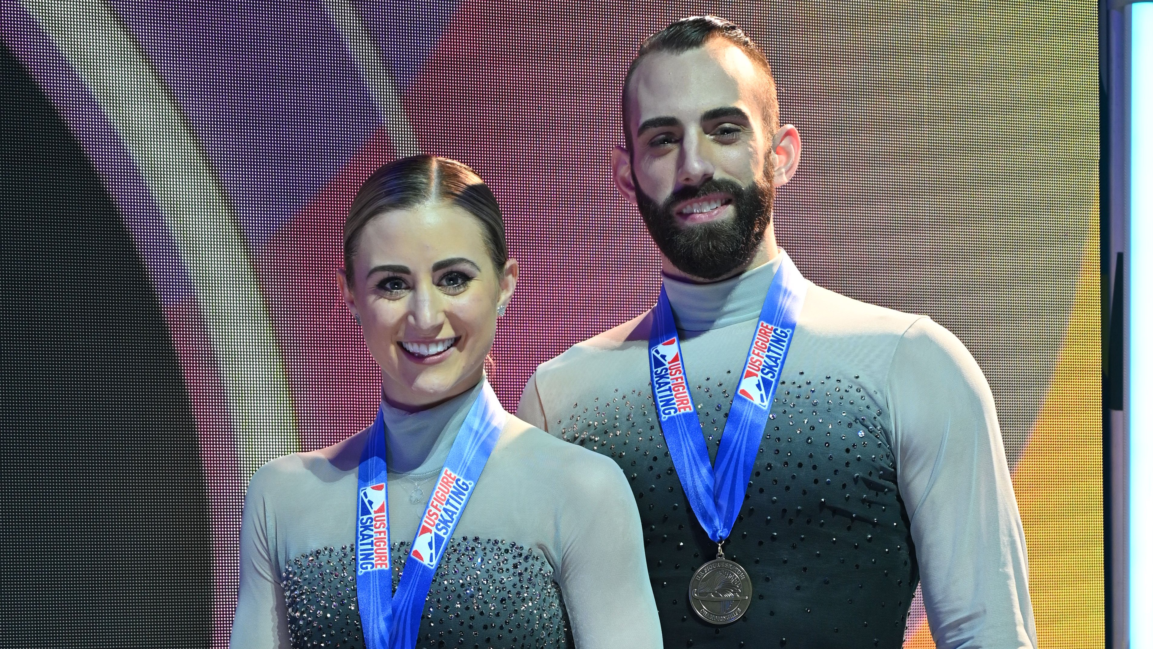 Ashley Cain Gribble and Timothy LeDuc stand for photos with their medal at the 2021 U.S. Figure Skating Championships