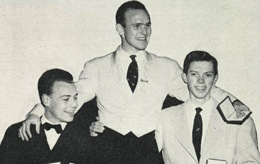 Dick Button is held up by fellow competitors after winning gold at the 1952 Olympic Games.