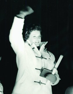 Tenley Albright waves to the crowd at her Olympic medal ceremony in 1956