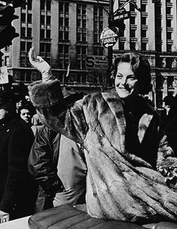 Carol Heiss waves to the crowd at the ticker tape parade.