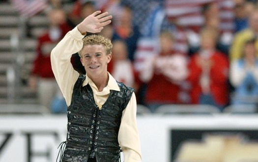 Timothy Goebel waves to the crowd at the end of his skate at the 2003 World Championships.