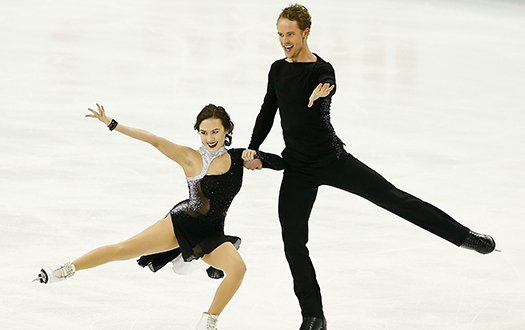 MAdison Chock and Evan Bates perform a spin element at the 2015 World Championships.