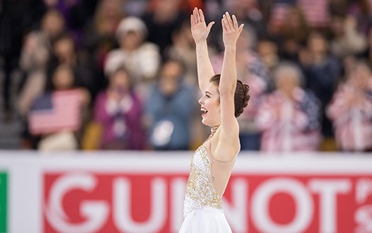 Ashley Wagner smiles and laughs with arms outstretched after the end of her free skate at 2016 World Championships.