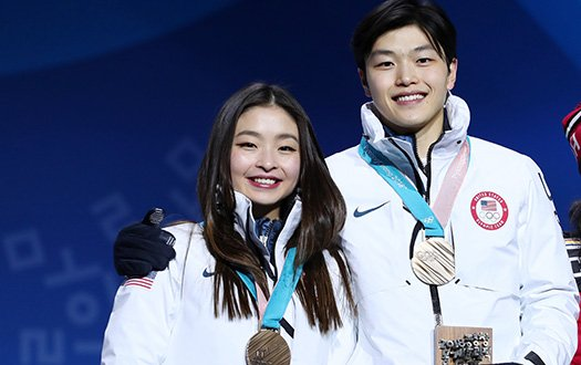 Maia and Alex Shibutani pose with their bronze medals on the medal stand.