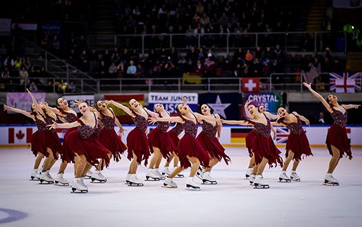 The Skyliners, wearing red, perform an element at the 2019 World Championships.