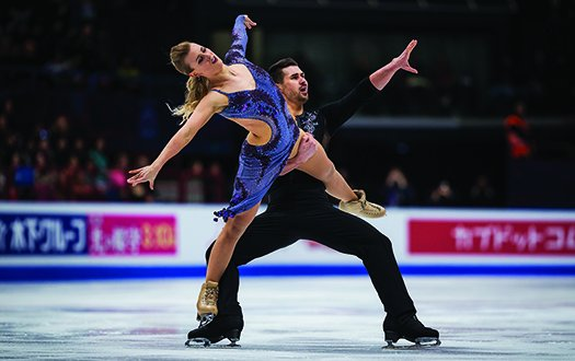Madison Hubbell stands on Zachary Donohue's right foot while performing a lift.