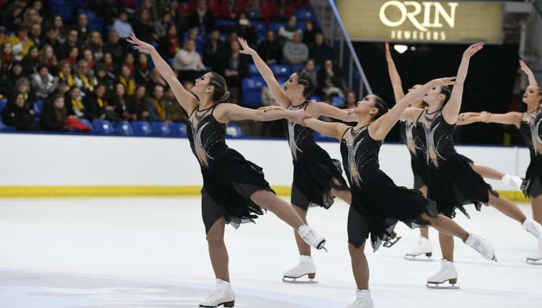 The Miami University Varsity Synchro Team competes in black dresses and dark makeup in 2019.