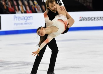 Kaitlin Hawayek and Jean-Luc Baker perform a dance lift during the free dance at the 2021 Toyota U.S. Figure Skating Championships.