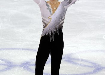 Johnny Weir waves to crowd after free skate at the 2010 Olympic Winter Games