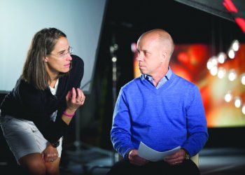 Lisa Lax talks with Scott Hamilton prior to shooting RISE.