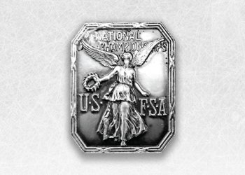 The original USFSA logo featured a Greek figure in silver plating.